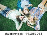 trendy hipster girls relaxing... | Shutterstock . vector #441053065