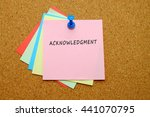 Small photo of Acknowledgment written on color sticker notes over cork board background.