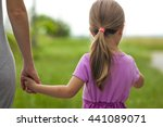 little girl holding a hand of... | Shutterstock . vector #441089071