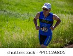 Small photo of Lory State Park, CO, USA - June 18, 2016: Bob Koehler of Cheyenne runs the trails en route to winning the male 60-64 age group at XTERRA Lory.