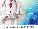 doctor hold injection syringe   ...   Shutterstock . vector #441141307