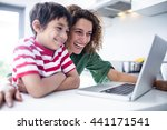 Mother And Son Using Laptop In...