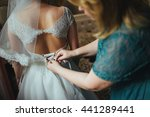bridesmaid makes bow knot on... | Shutterstock . vector #441289441