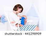 young mother breast feeding her ... | Shutterstock . vector #441298909