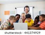 happy teacher and pupils using... | Shutterstock . vector #441374929