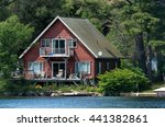 Red Cottage On A Lake