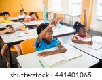 pupils raising their hands in... | Shutterstock . vector #441401065