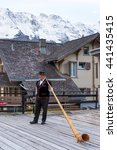 Small photo of zurich,switzerland:alphorn performance on wooden floor before house near alpes mountains by zhudifeng on Oct 12 2015