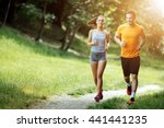 beautiful couple jogging in... | Shutterstock . vector #441441235