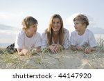 Family at the beach early morning - stock photo