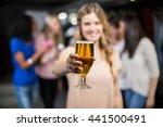 smiling girl showing a beer...   Shutterstock . vector #441500491
