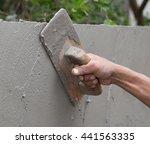 hand of builder worker use... | Shutterstock . vector #441563335