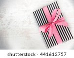 Gift Box Wrapped In Black And...