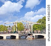 Small photo of AMSTERDAM-AUG. 19, 2012. The famous Meager Bridge in canal belt. Amsterdam is known as Venice of the North. It has 1,200 bridges and 165 canals. Best way to experience them is one of the boat tours