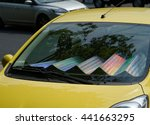 The Car With Sun Shade On The...