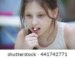 girl on bed taking pill   Shutterstock . vector #441742771