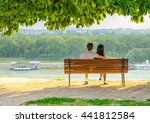 young couple under the tree... | Shutterstock . vector #441812584