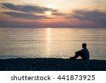 Man Silhouette Sitting On Beac...