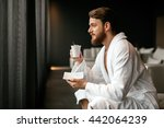 handsome man relaxing drinking... | Shutterstock . vector #442064239