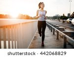 beautiful woman running over... | Shutterstock . vector #442068829