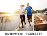 active couple jogging outdoors... | Shutterstock . vector #442068859