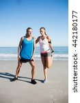 couple stretching at the beach... | Shutterstock . vector #442180177