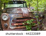 Junk Yard Vehicles Showing Old...