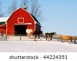 Horses at a red barn - stock photo