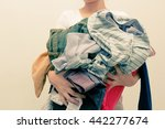 woman holding a huge pile of... | Shutterstock . vector #442277674