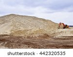 Small photo of Working digger in a quarry produces sand.