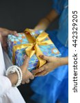 two young girls sharing a gift. ... | Shutterstock . vector #442329205