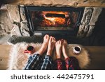 bare couple feet by the cozy... | Shutterstock . vector #442475791