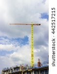 Small photo of London, England - May 27, 2016: A series of vibrant and colourful cranes are used on this construction site to animate the Greenwich Peninsula Skyline alongside the River Thames in London, England.