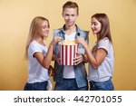 three young people with popcorn   Shutterstock . vector #442701055