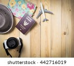 Small photo of Air Traveller equipments flat lay on wooden background.