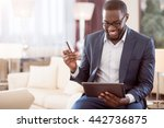 man holding bank card and tablet | Shutterstock . vector #442736875