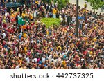 Small photo of CLEVELAND, OH - JUNE 22, 2016: Massive crowds cheer and wave in adulation as the NBA champion Cavaliers ride by in their history-making victory parade in downtown Cleveland.