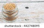 yellow mustard seed in mason... | Shutterstock . vector #442748095