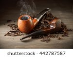 Two Wooden Pipe With Smoke And...