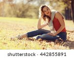 girl sits resting in a park on... | Shutterstock . vector #442855891