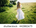 Stock photo young girl in a white dress in the meadow woman in a beautiful long dress posing in the garden 442882675