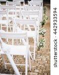 wedding ceremony. white chairs...   Shutterstock . vector #442933594