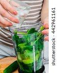 woman blending spinach ... | Shutterstock . vector #442961161