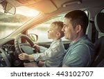 father and son driving in car | Shutterstock . vector #443102707
