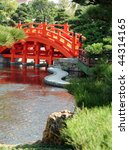 Arched bridge in a Chinese garden - stock photo