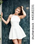 Young beautiful girl posing outdoor, wearing fashionable white dress. Summer style.