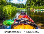 Colorful Kayaks On The River...