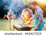 young people enjoying barbecuing | Shutterstock . vector #443417329