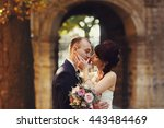 bride holds groom's cheek... | Shutterstock . vector #443484469