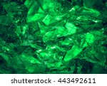 Small photo of Glare sharp birthstone stack glisten depth fond of shiny vibrant dense irish mint malachite color lit by jade bio vert glow. Closeup view with space for text on ice refraction sparkle carbon ore heap